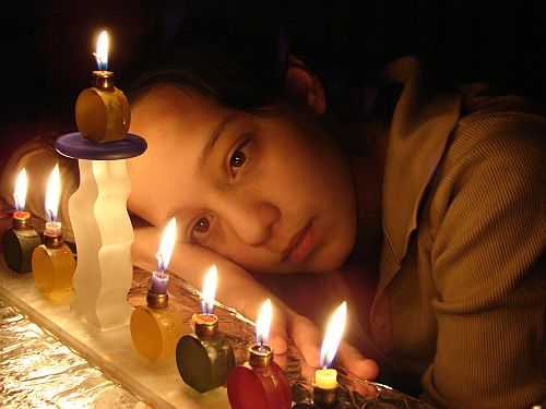 1126834_kids_behind_chanukah_menorah_updated_3