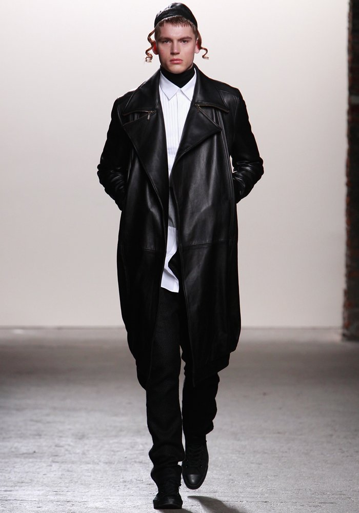 designer-ricardo-seco-sent-this-model-down-the-runway-in-a-harsh-leather-coat-and-what-looked-like-payot-hair-curls-worn-by-hasidic-jews
