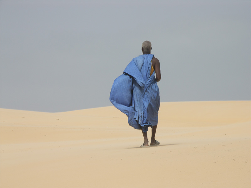 man-walking-through-the-desert